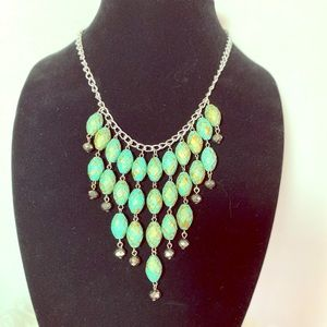 Fashion bib necklace in turquoise and gold patina